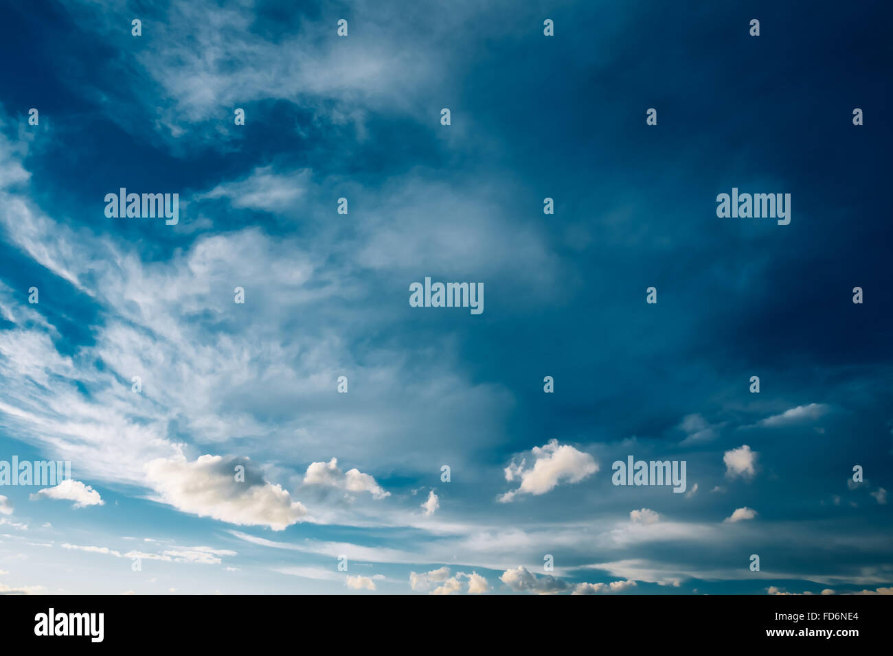 Blue Sky and Fluffy Clouds, Bright Cloudscape - Stock Image