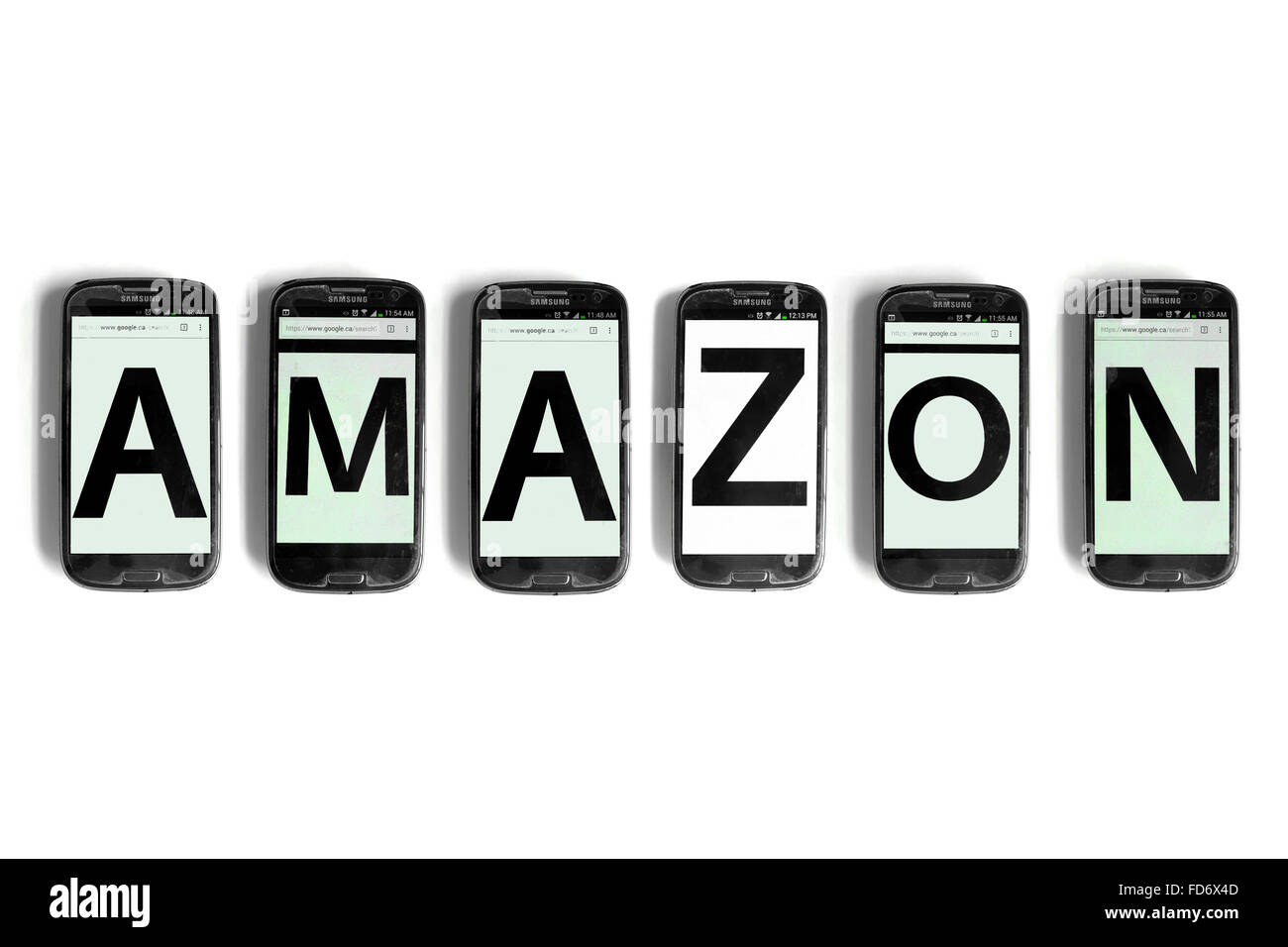 Amazon spelled on the screens of smartphones photographed against a white background. - Stock Image