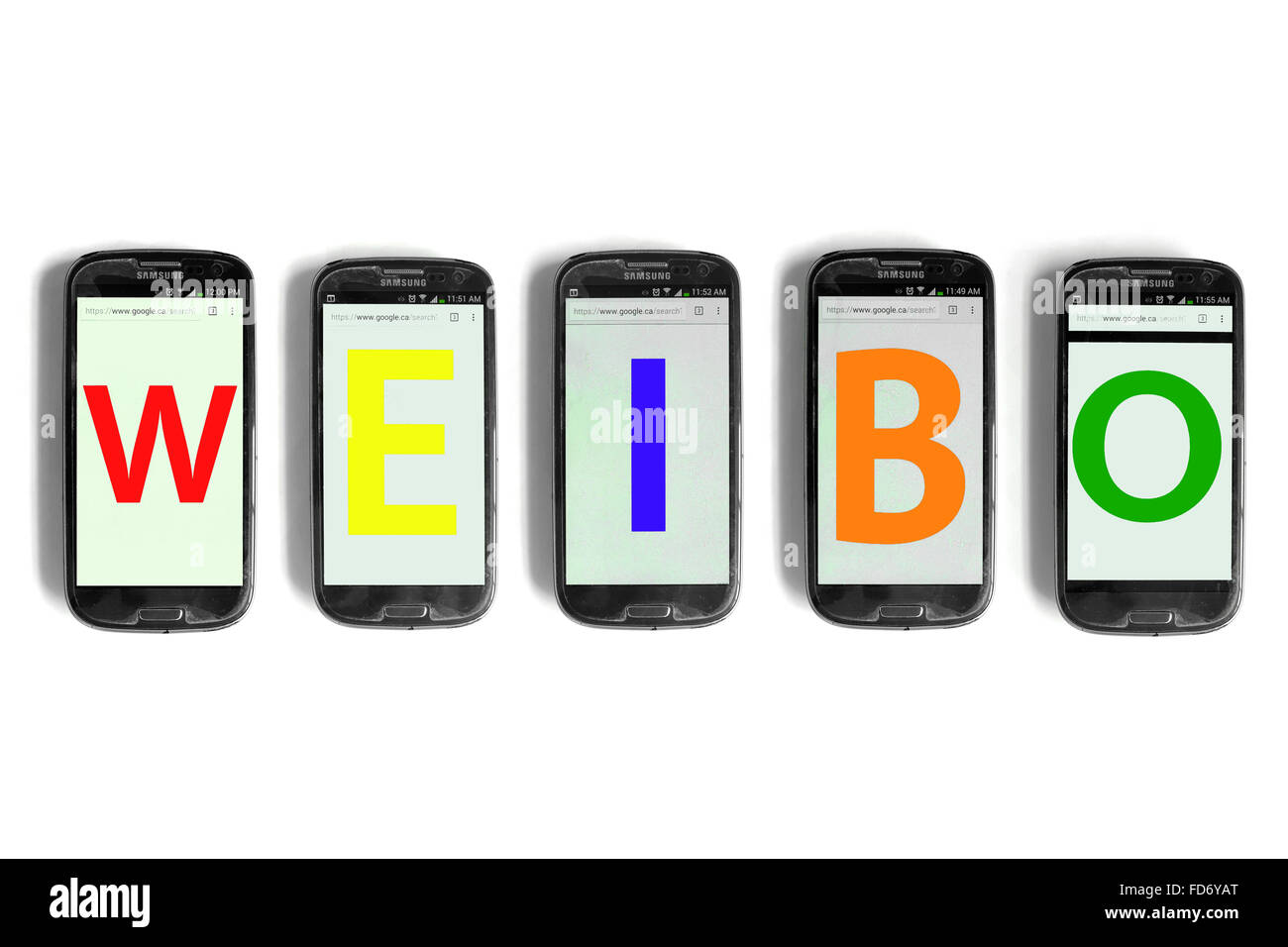 Weibo spelled on the screens of smartphones photographed against a white background. - Stock Image