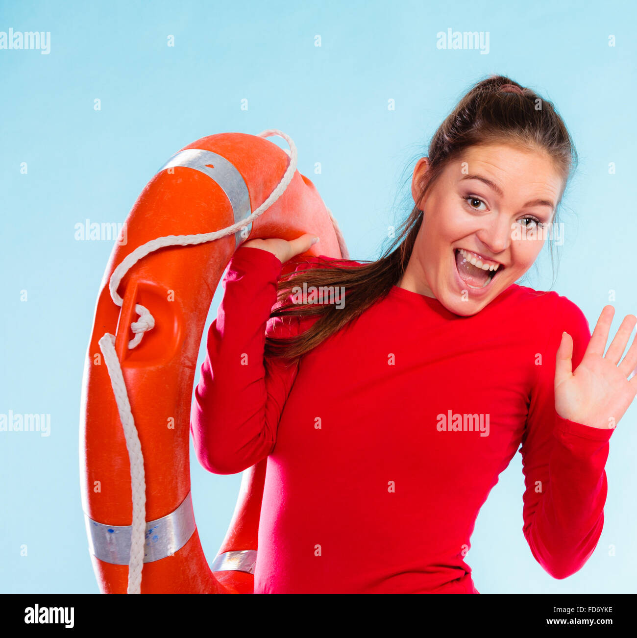 1840453ac71 Accident prevention and water rescue. Young woman female smiling lifeguard  on duty holding lifesaver equipment having fun.