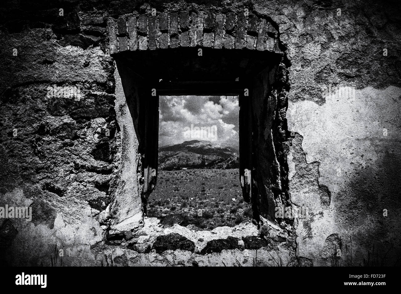 Mountain Seen Through Abandoned Window - Stock Image