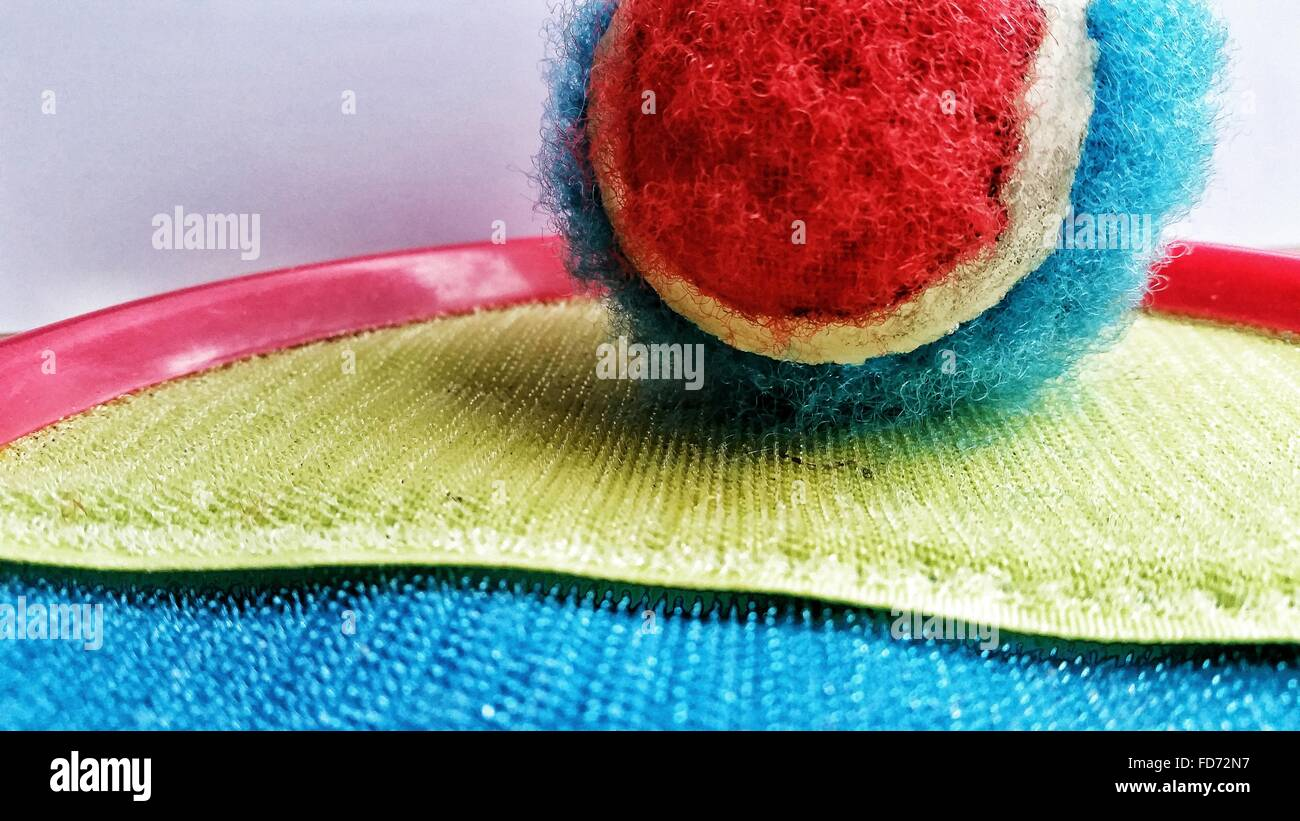 Close-Up Of Velcro Tennis Ball On Door Mat - Stock Image