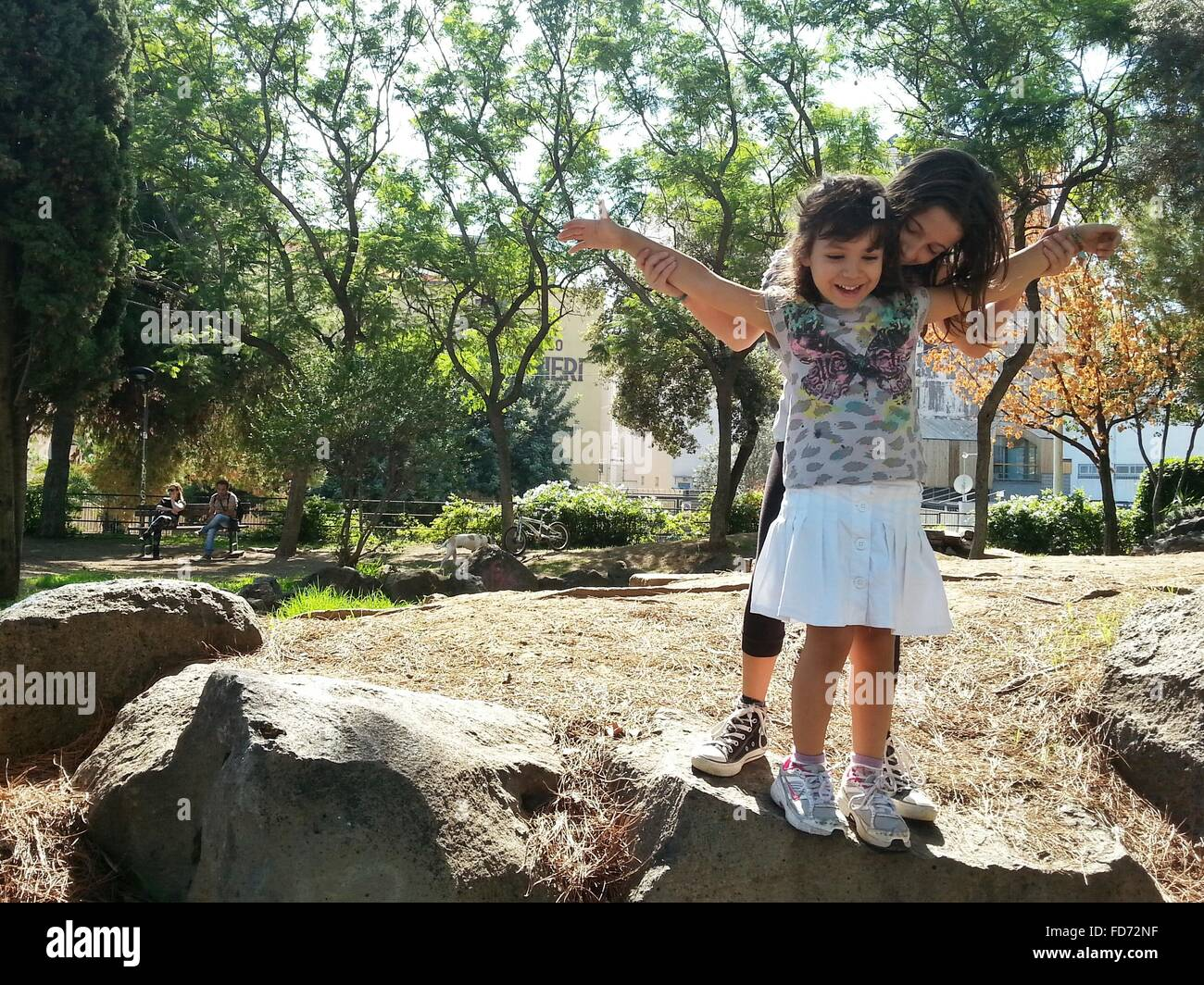 Siblings Enjoying In Park - Stock Image