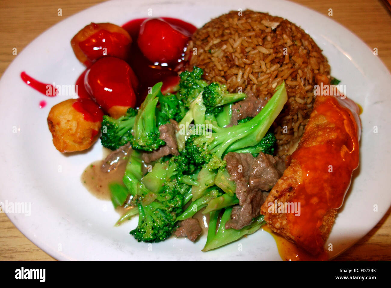 A combination plate of meat, chicken balls and fried rice of North American Canadian Chinese food - Stock Image