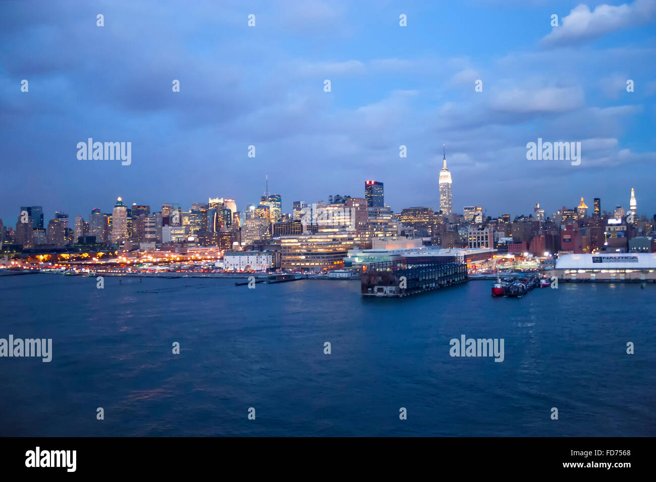 The panorama of Midtown Manhattan coast viewed from the Hudson River at night in New York City, USA. Stock Photo