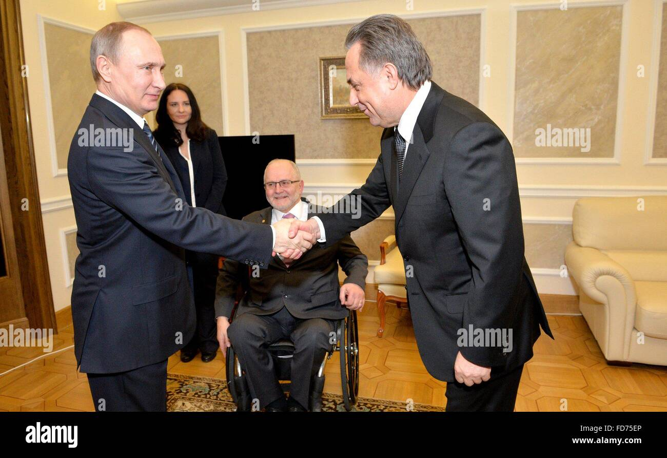 Moscow, Russia. 28th January, 2016. Russian President Vladimir Putin greets Russian Minister of Sport Vitaly Mutko - Stock Image