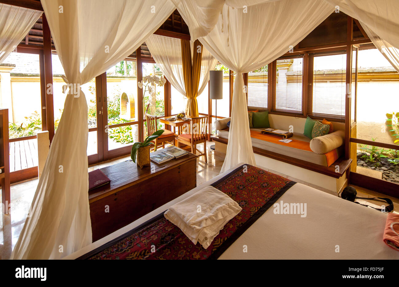 Hotel rooms with four-poster bed, tourism, travel, Ubud, Bali, Indonesia, Asia - Stock Image