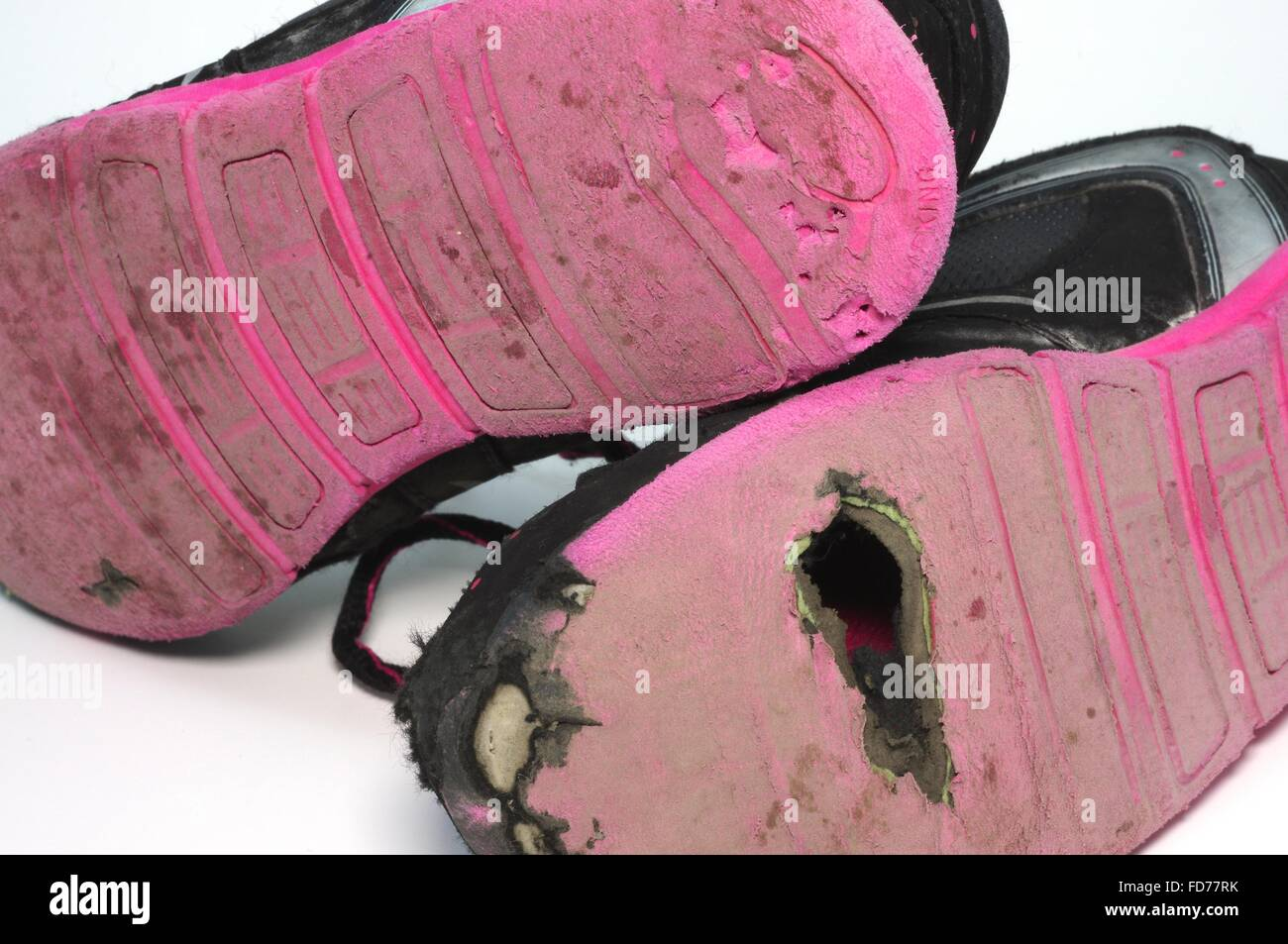 Worn out kids shoes. - Stock Image