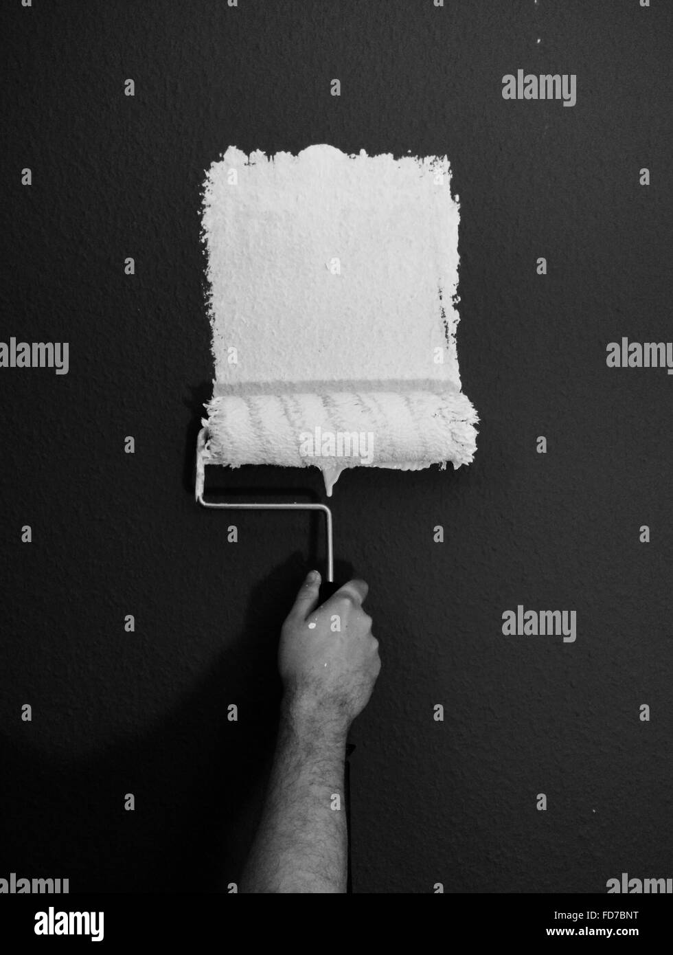 Cropped Hand Painting Wall - Stock Image