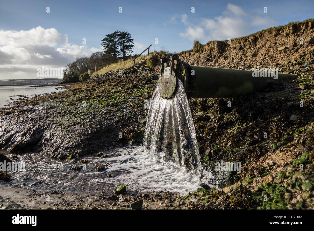 Waste water flows out of an outflow waste water pipe into the river in Devon UK & Water Waste Overflow Pipe Stock Photos u0026 Water Waste Overflow Pipe ...