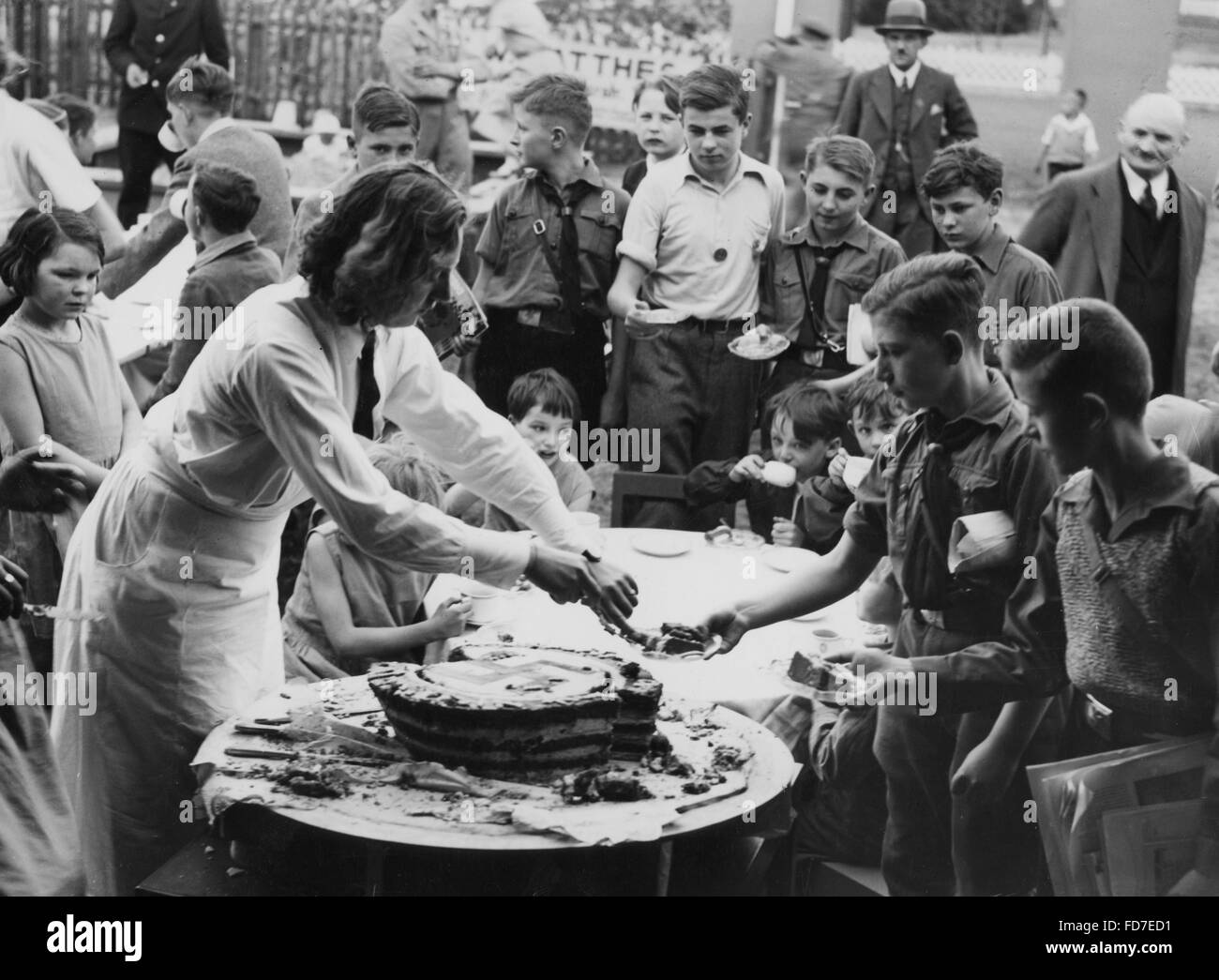 Magnificent Hitlers Birthday Cake Is Being Shared 1934 Stock Photo 94207373 Birthday Cards Printable Riciscafe Filternl