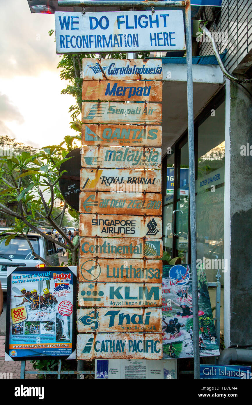 Street sign of a travel agency, Flight Confirmation, Flight reconfirmation for Airlines Garuda Indonesia, Merpati, - Stock Image
