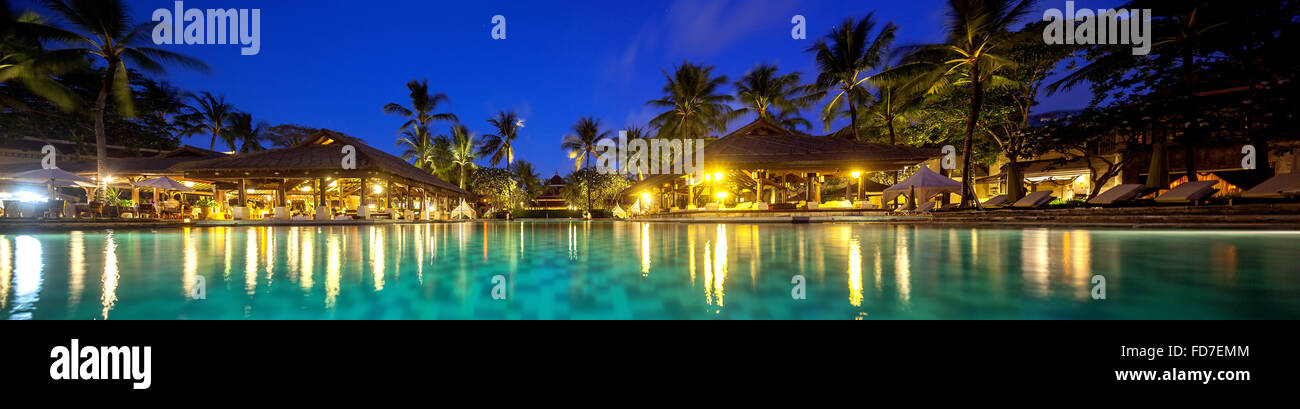Hotel resort with pool at night, a poolside bar, InterContinental Bali Resort, Panorama,Blue Hour,turquoise waters, - Stock Image