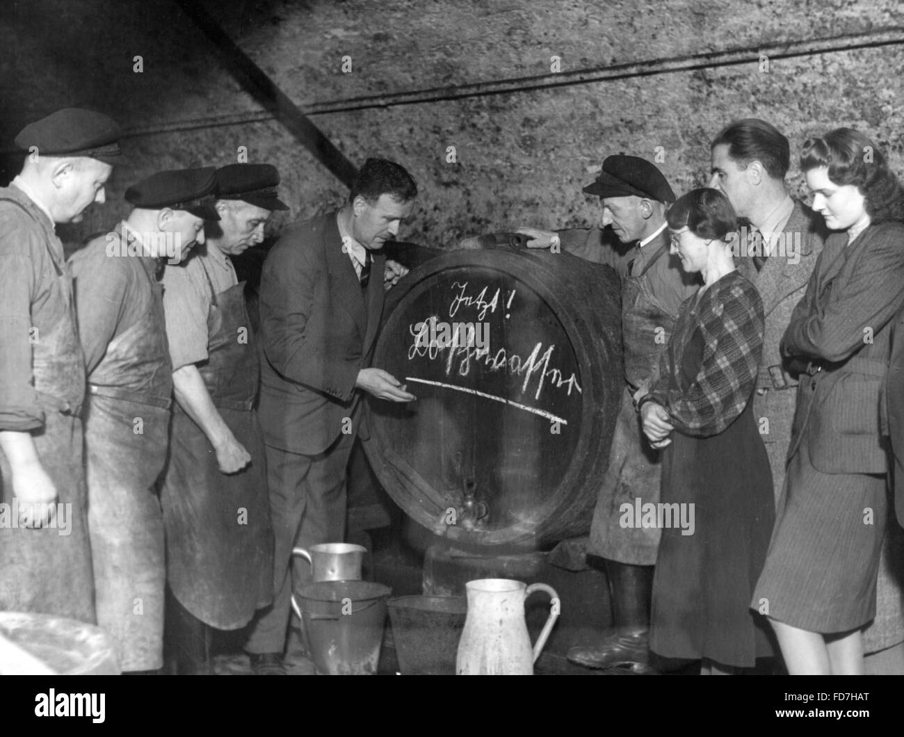 Wine barrel as a fire water container in Mainz, 1941 - Stock Image