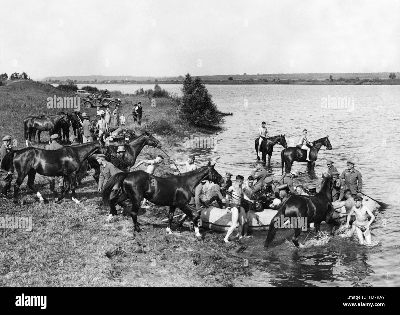 Cavalry of the Wehrmacht practices river crossing in the 30s Stock Photo