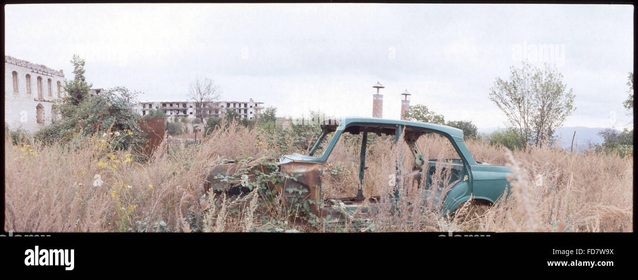 Remnants Of Abandoned Car In Wasteland - Stock Image