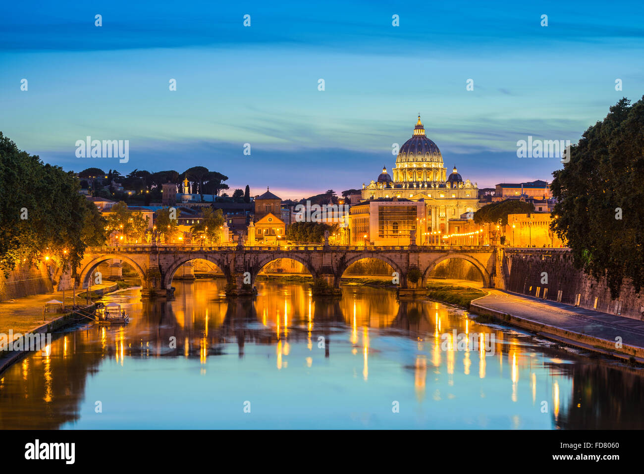 Saint Peter Basilica and Sant Angelo bridge , Rome , Italy - Stock Image