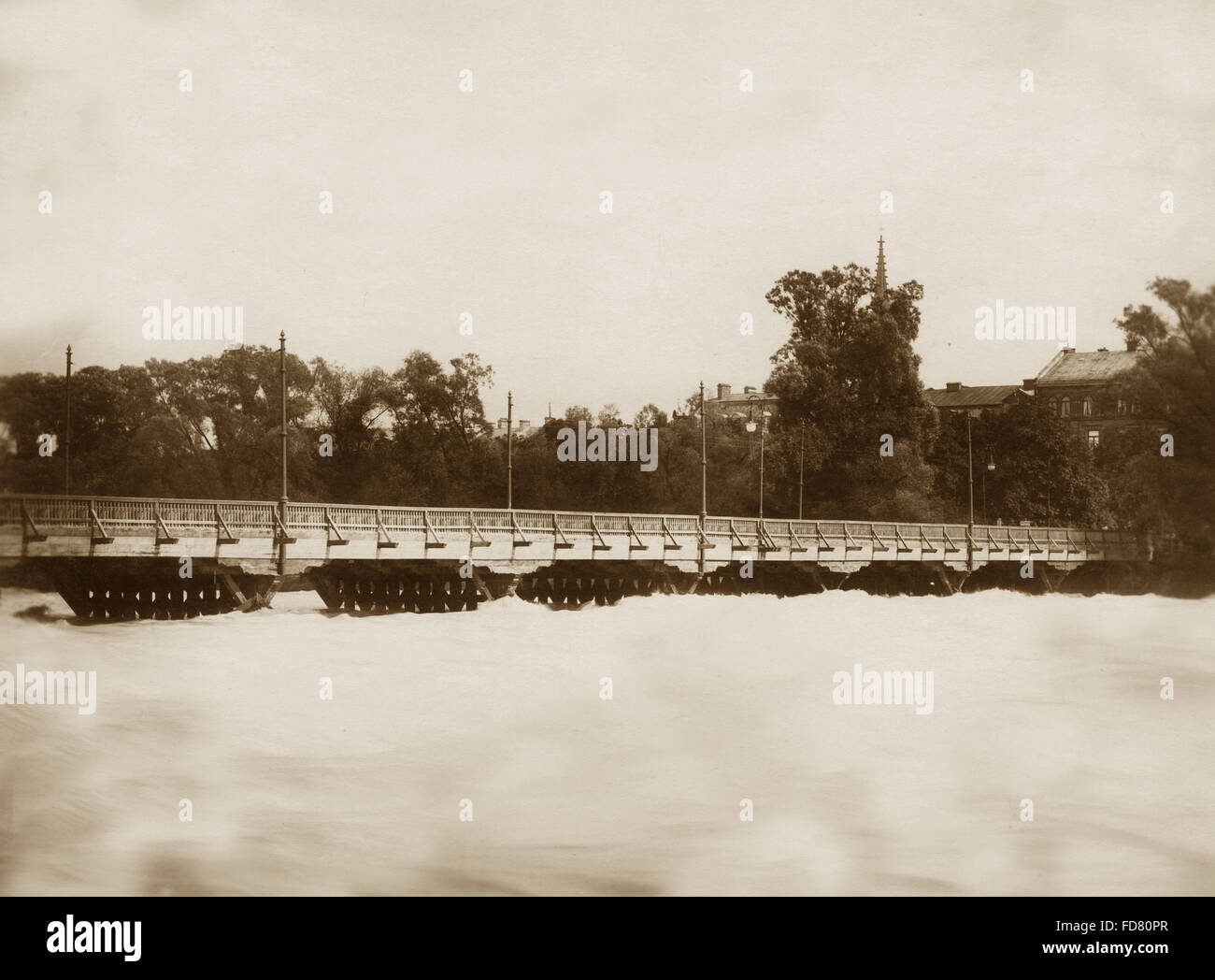 The Frauenhofer Brücke in Munich during the flood of 1899 - Stock Image
