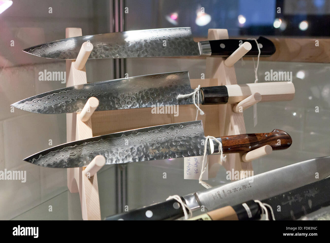 Hand crafted Japanese kitchen knives on display case Stock Photo ...