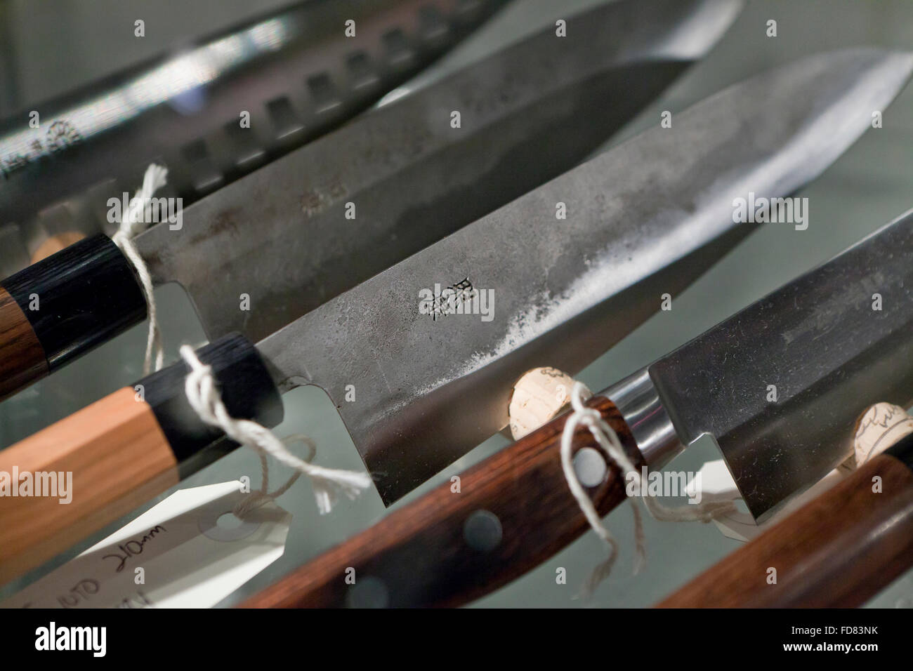 Hand crafted Japanese kitchen knives on display case - Stock Image