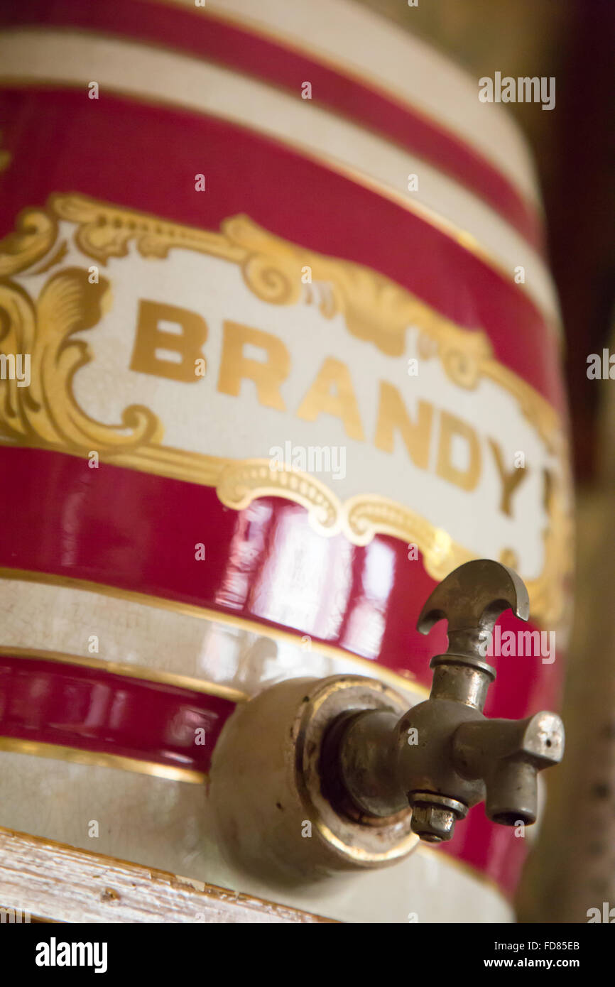 Abstract view of an antique Victorian glazed stoneware Spirit Barrel for Brandy, including the brass tap. - Stock Image