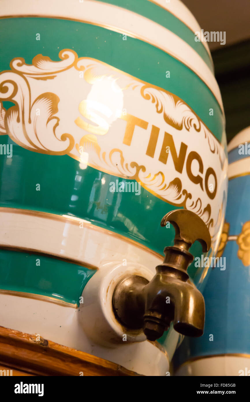 Abstract view of an antique Victorian glazed stoneware Spirit Barrel for Stingo, including the brass tap. - Stock Image