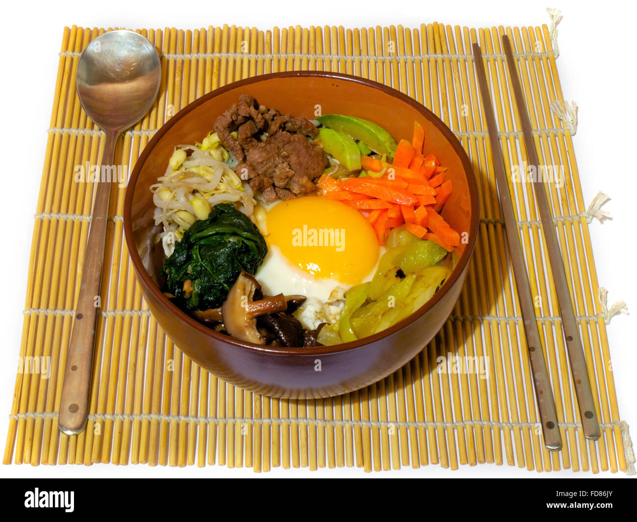 Bibimpab korean dish with vegetables, beef and egg on rice - Stock Image