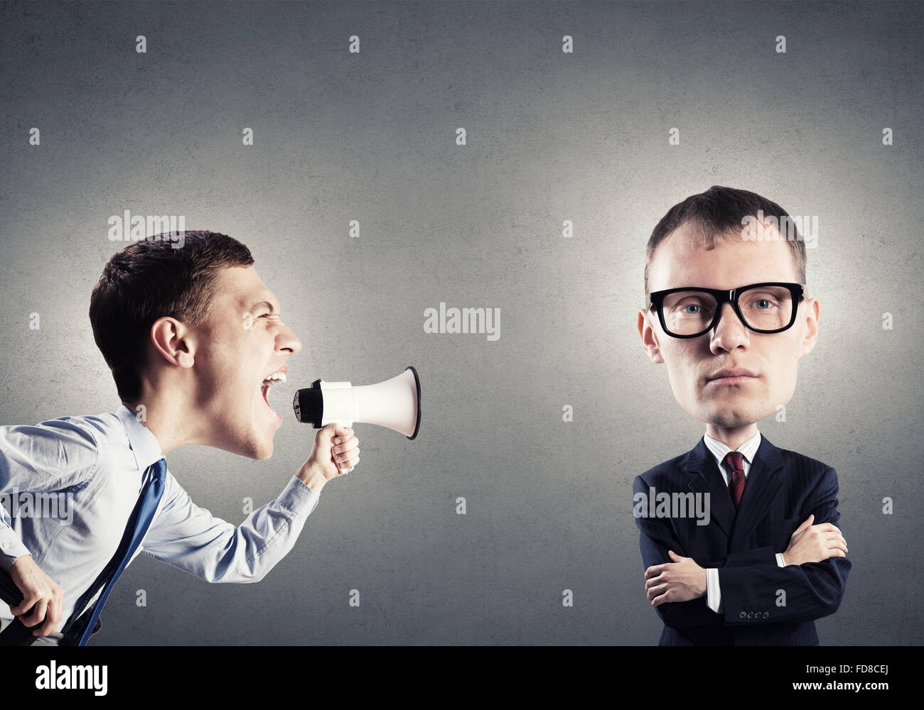 6a2cabdf620 Funny young man with big head screaming emotionally in megaphone - Stock  Image