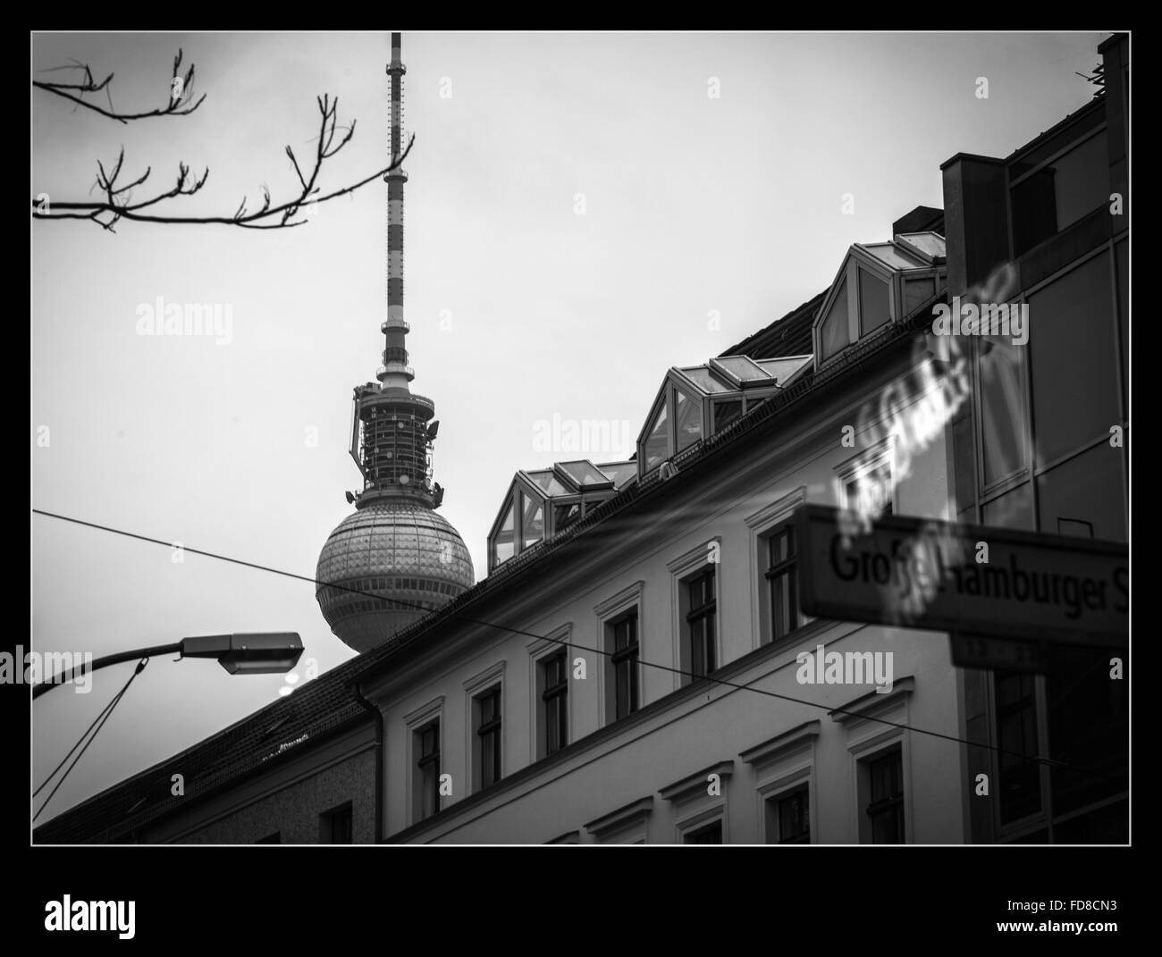 Low Angle View Of Fernsehturm And Building Against Clear Sky At Night - Stock Image