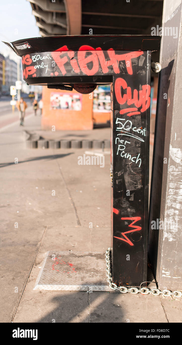 Old Punching Bag Machine By Street In City - Stock Image