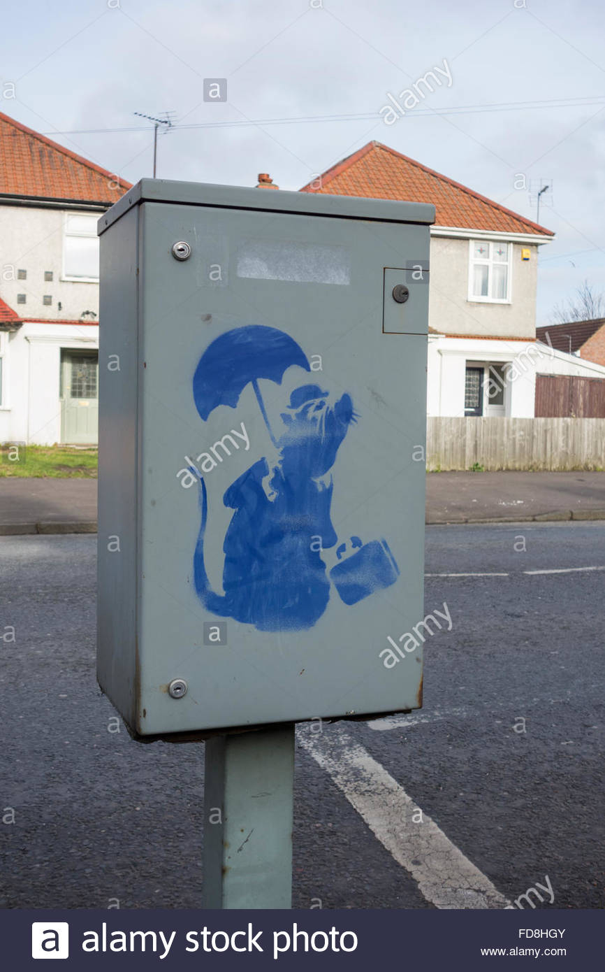 Blue stencil graffiti on an equipment case by the side of the road - Stock Image