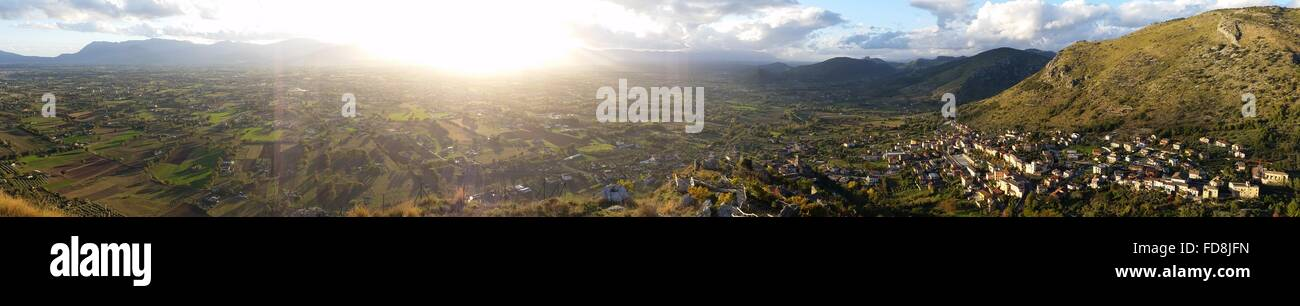 Panoramic View Of Human Settlement On Mountain Against Cloudy Sky - Stock Image