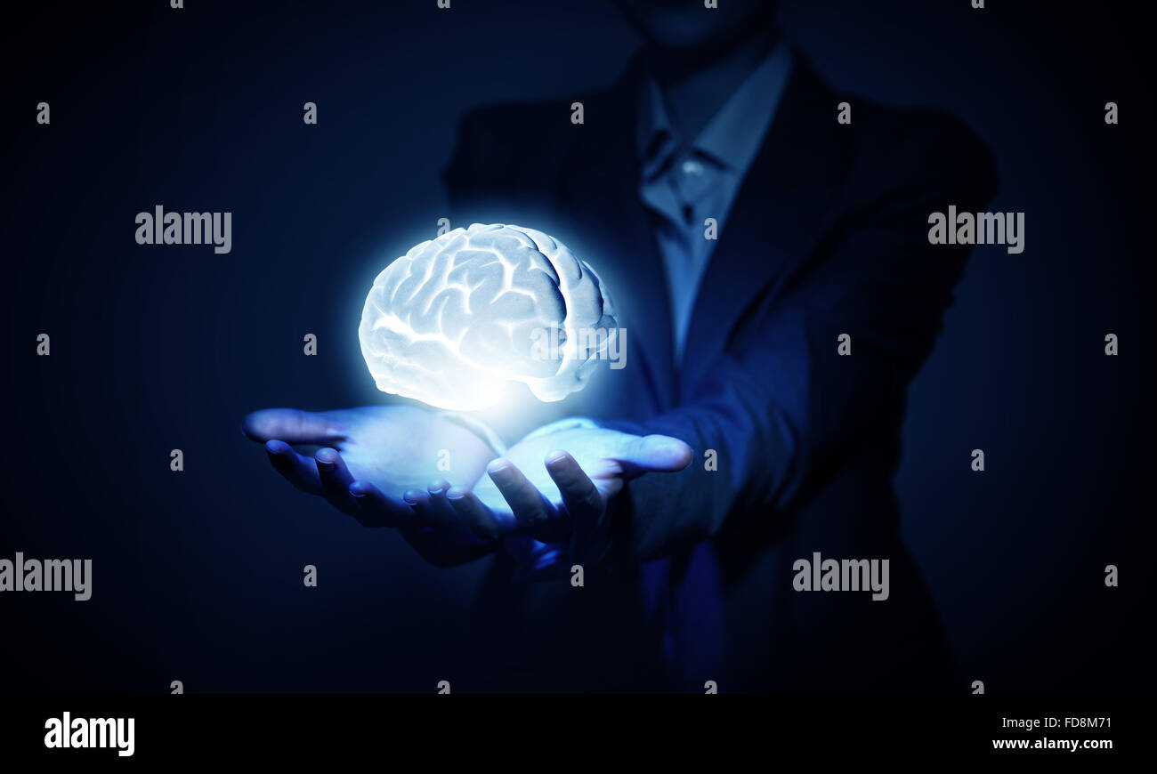 Brain in hand or save intelligence concept - Stock Image