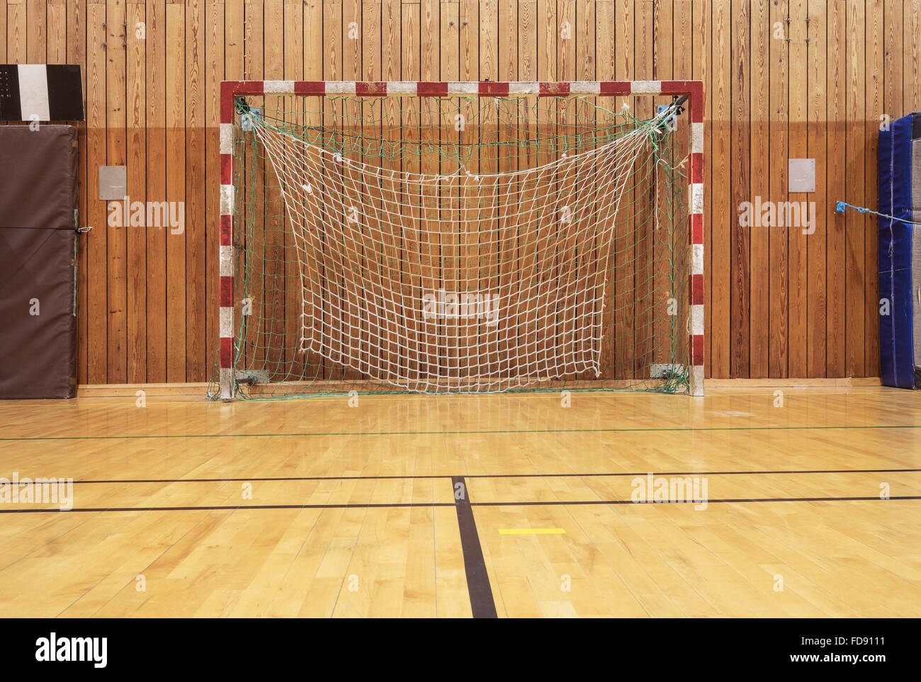 Soccer goal in an old gymhall - Stock Image
