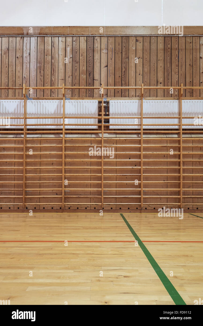 Timber wall bars in old gymhall - Stock Image