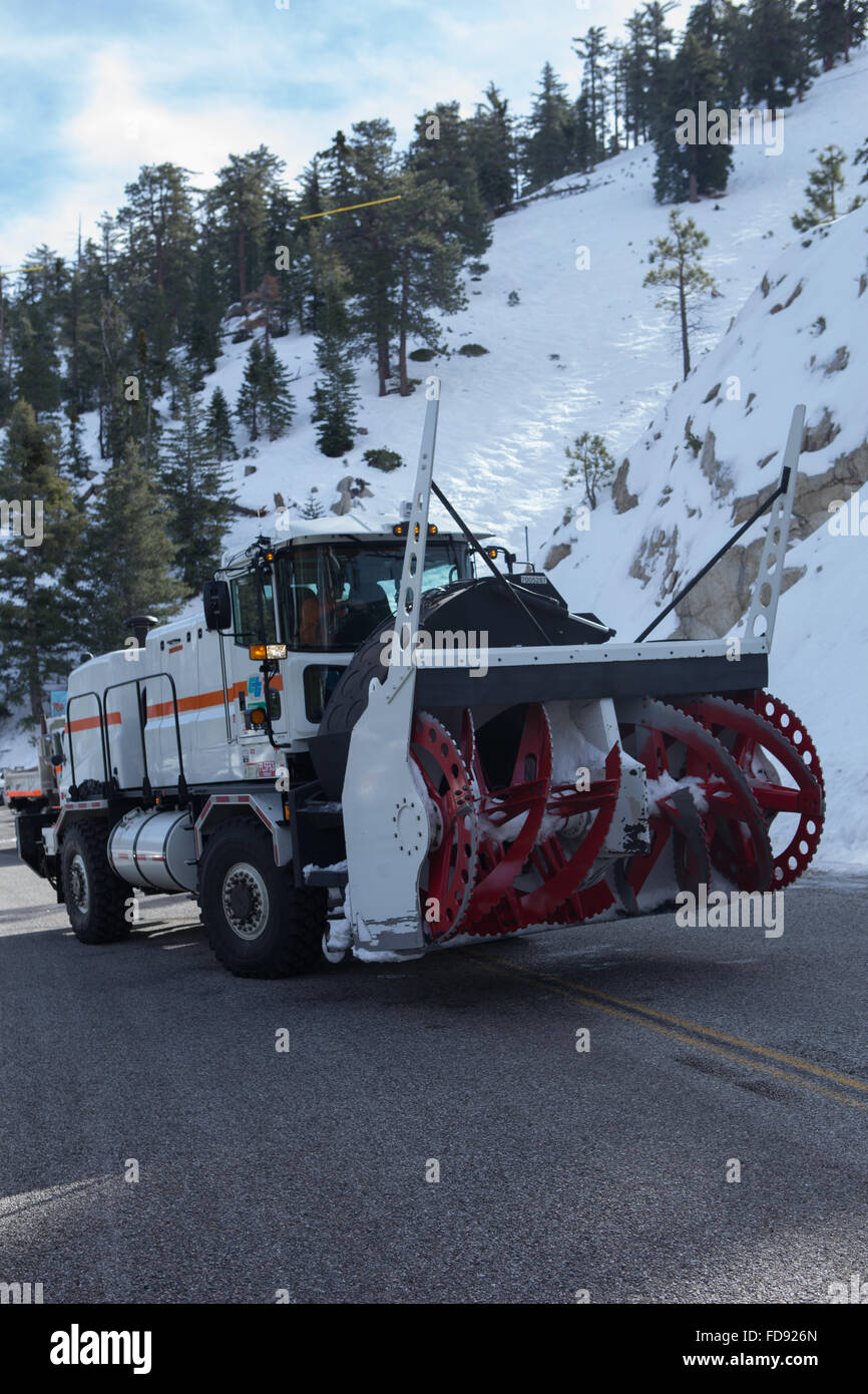 Cal Trans rotary snowplow blower on the Angeles Crest Highway in the Angeles National forest  Southern California - Stock Image