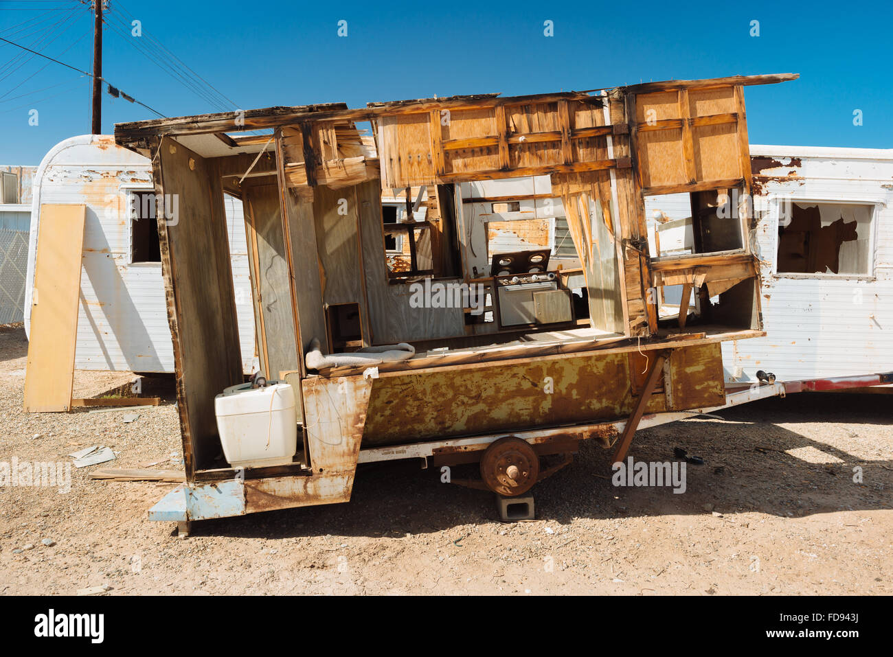 An abandoned camping trailer in Bombay Beach, California, on the eastern shore of the Salton Sea - Stock Image