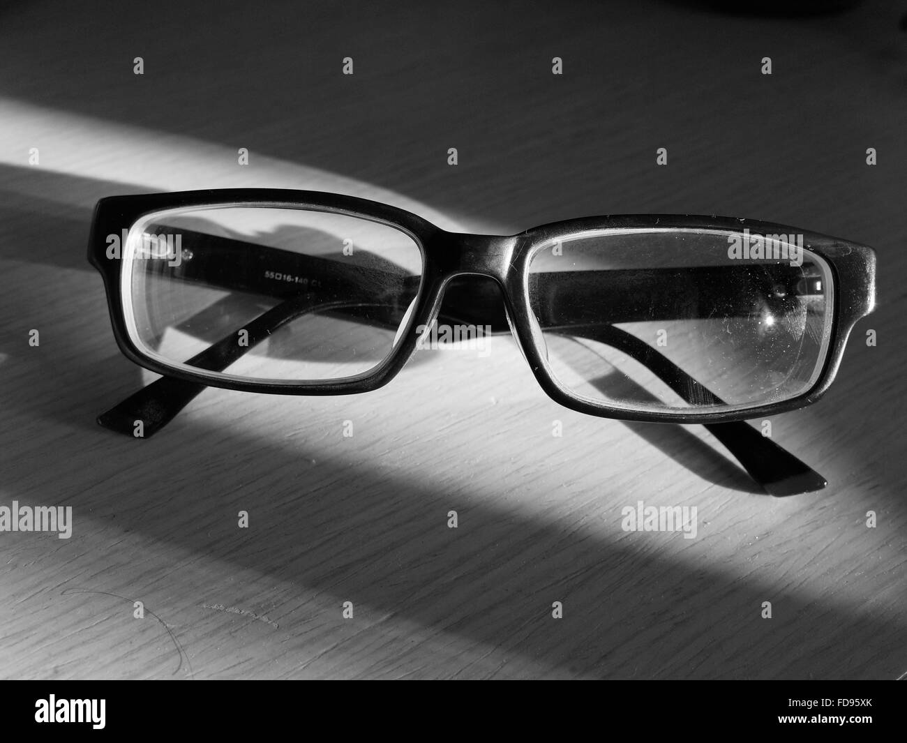 Close-Up Of Eyeglasses On Table - Stock Image