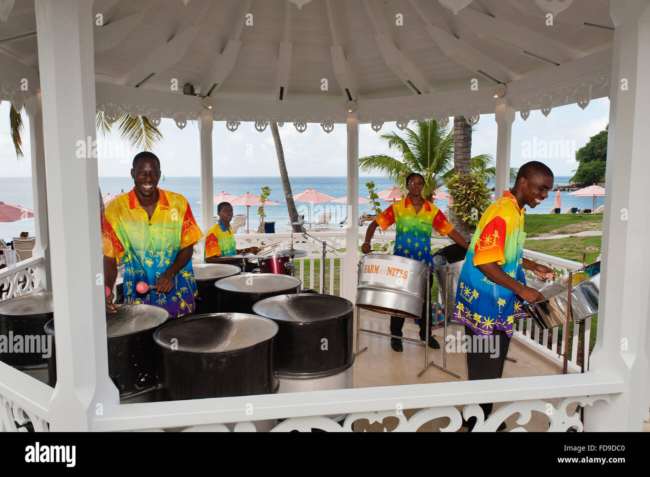 Steel drummers play in beach pagoda, St Lucia,  Lesser Antilles, Caribbean - Stock Image