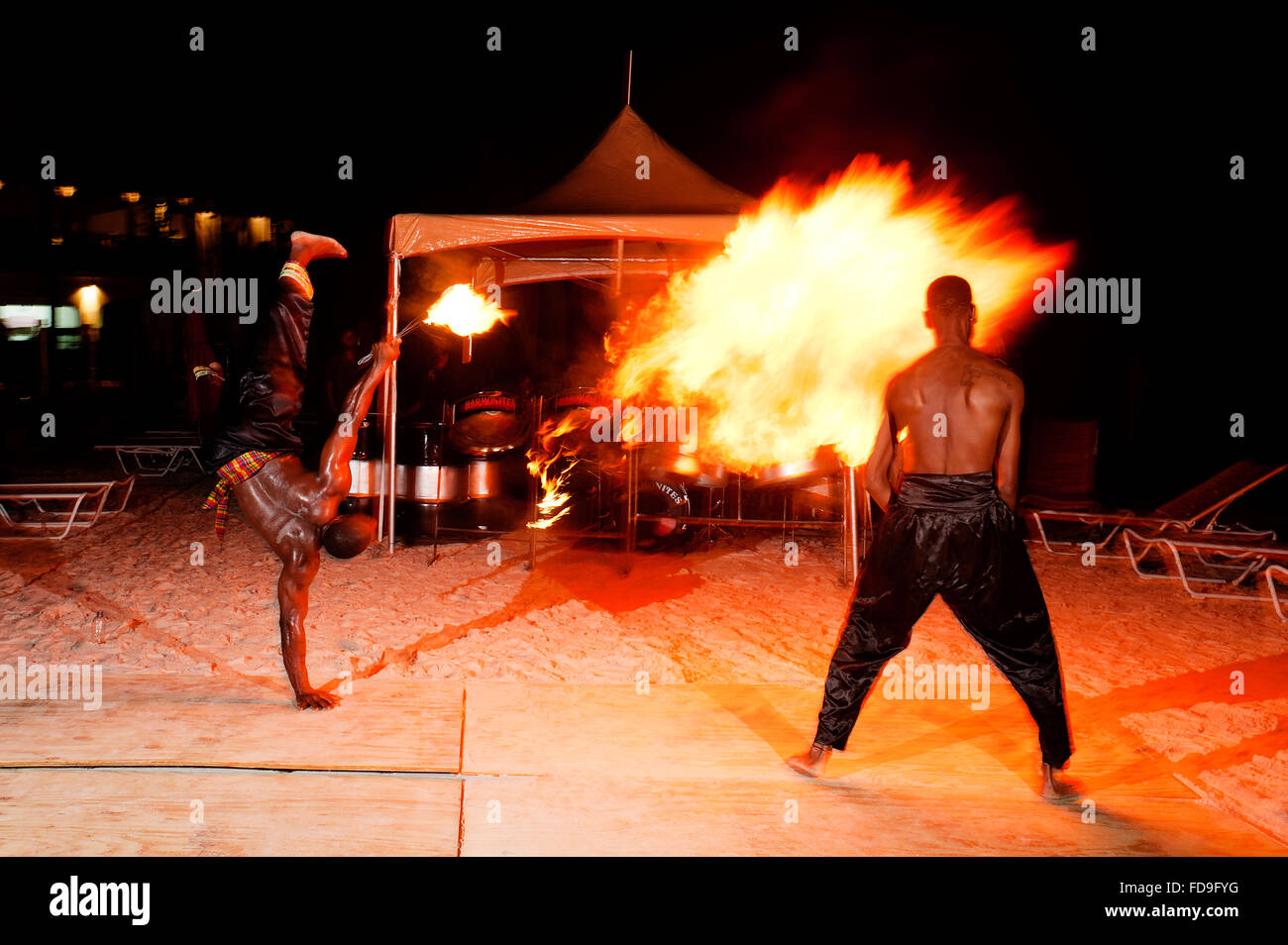 Flame throwers perform on the beach at night, Santa Lucia, Lesser Antilles, Caribbean - Stock Image