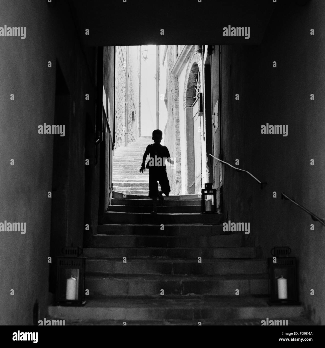 Silhouette Of Boy On Steps Stock Photo