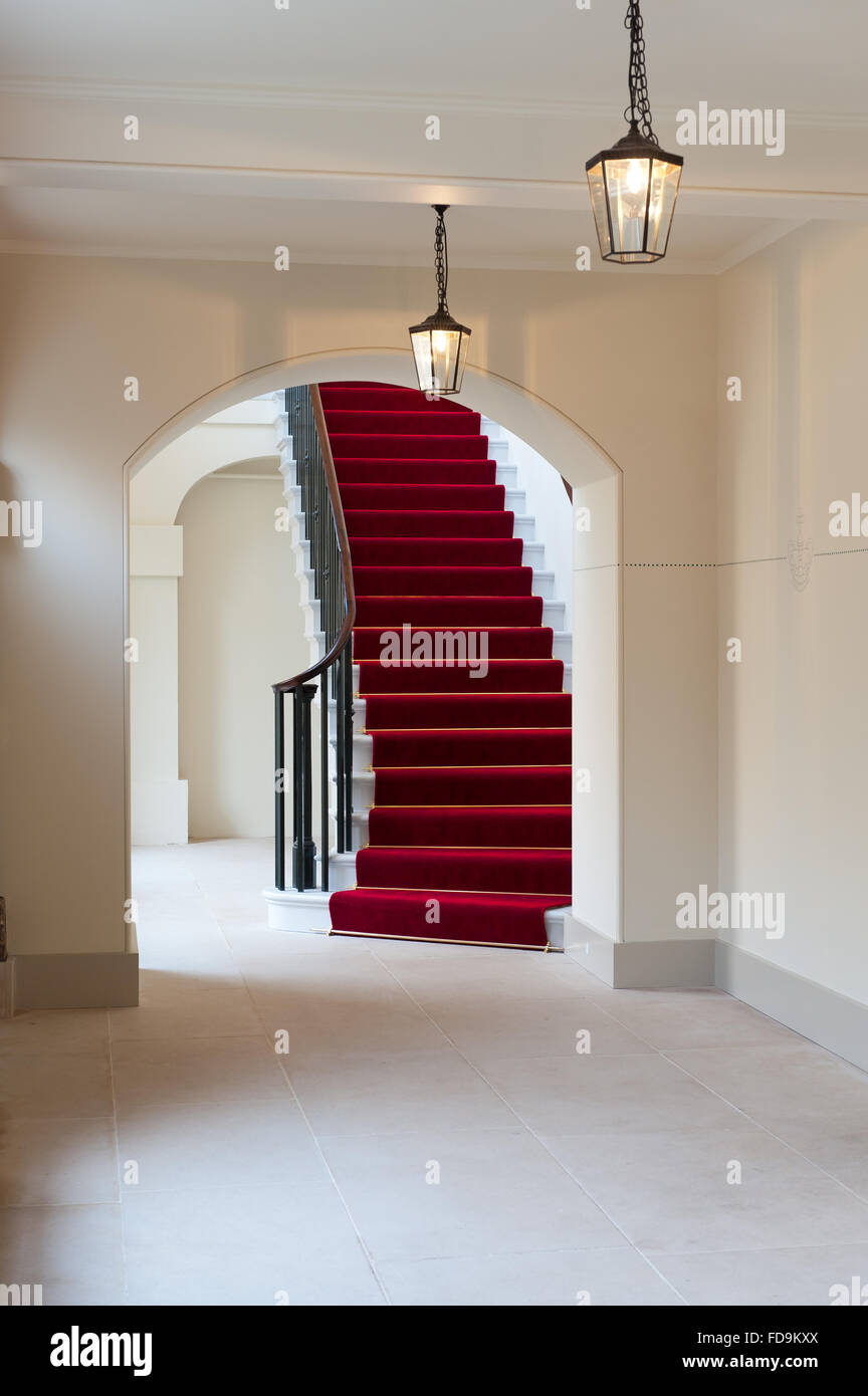 Red carpet and staircase in Kensington Palace, London, UK - Stock Image