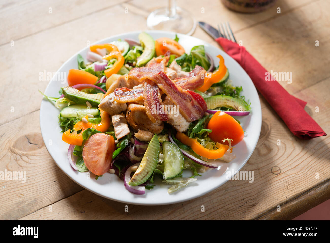 A bacon salad on a plate in a traditional English pub - Stock Image
