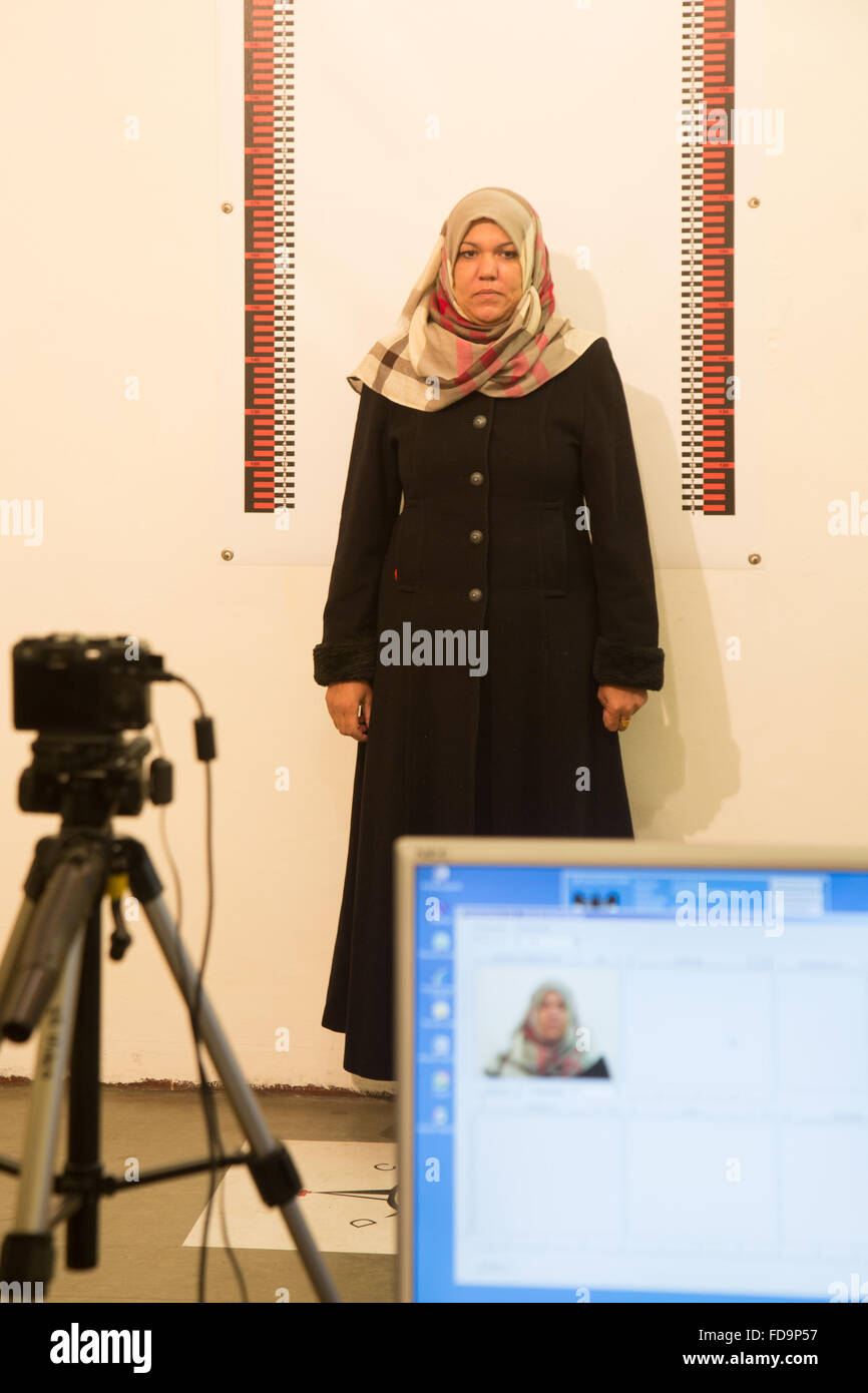 Berlin, Germany, a Syrian woman is photographed as asylum seekers for the initial recognition - Stock Image