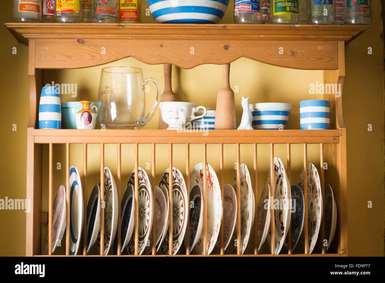A plate rack or dresser in a dining room or kitchen interior Stock