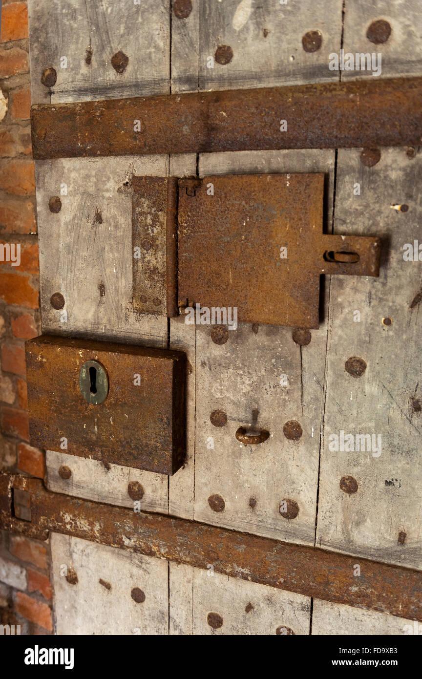 Metal lock and hatch on cell door in Walsingham prison, Norfolk, UK - Stock Image