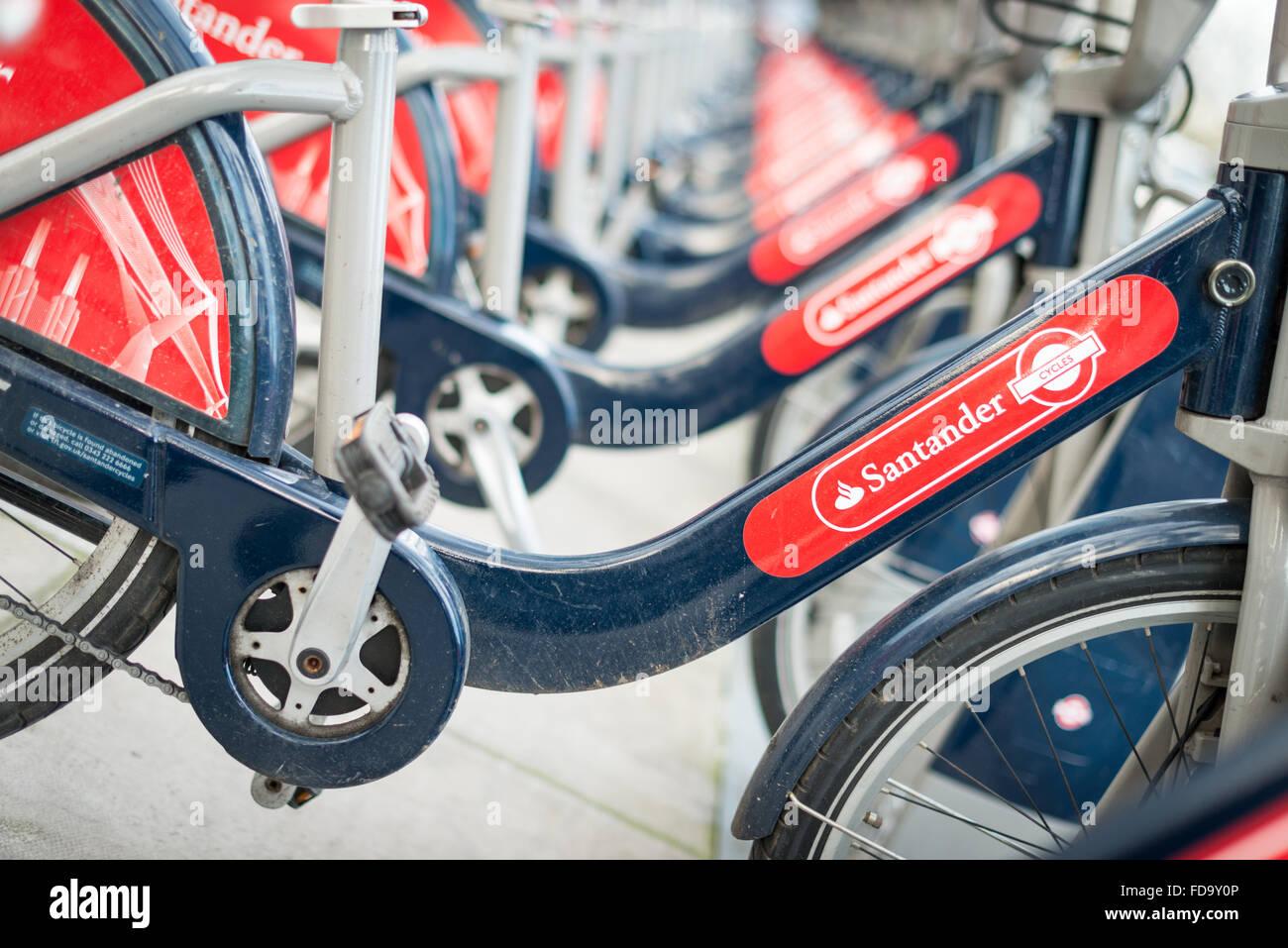 Santander Hire bikes, Boris Bikes or bicycles parked in London UK - Stock Image