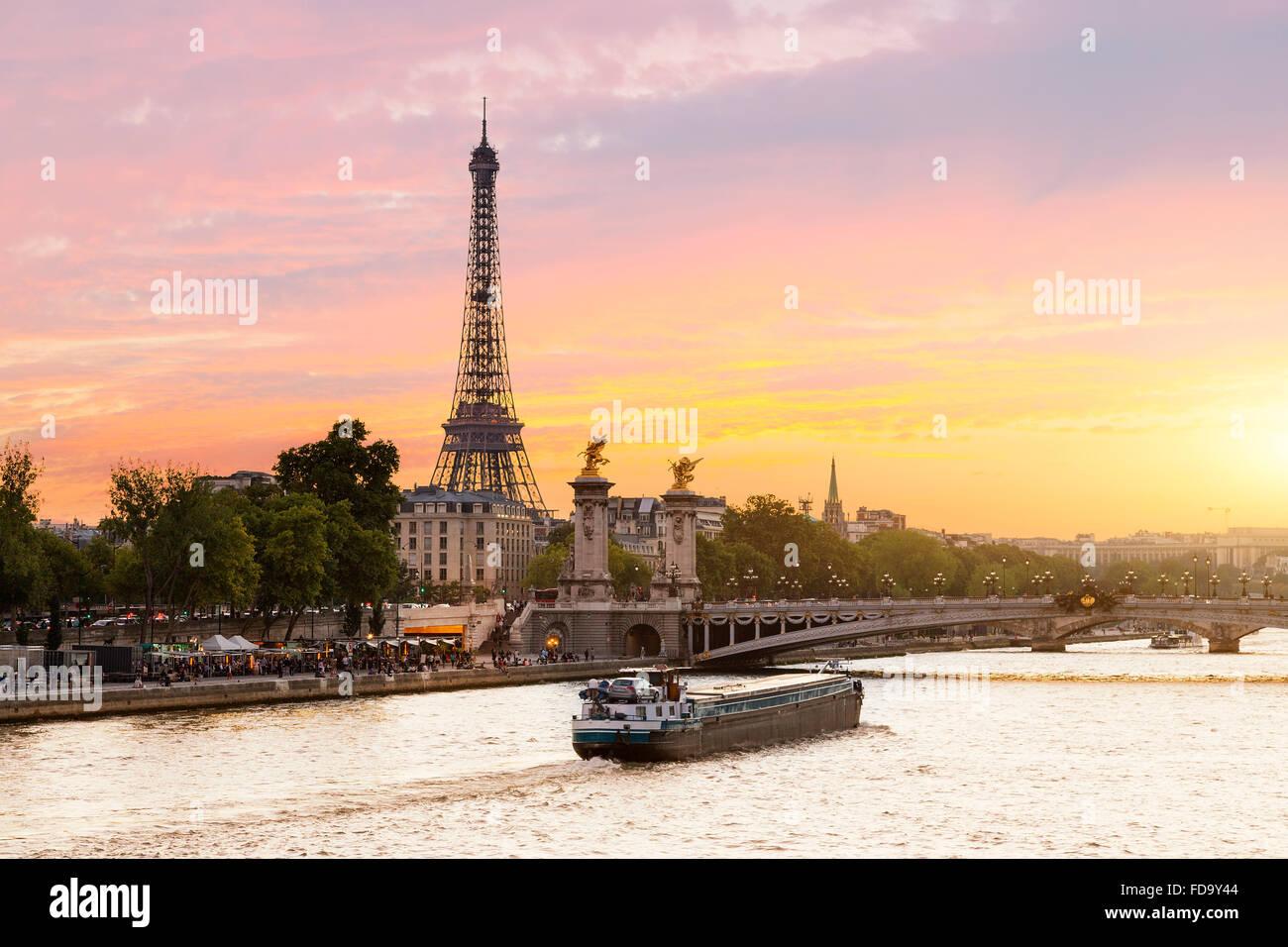 Paris Cityscape, sunset on Seine river - Stock Image