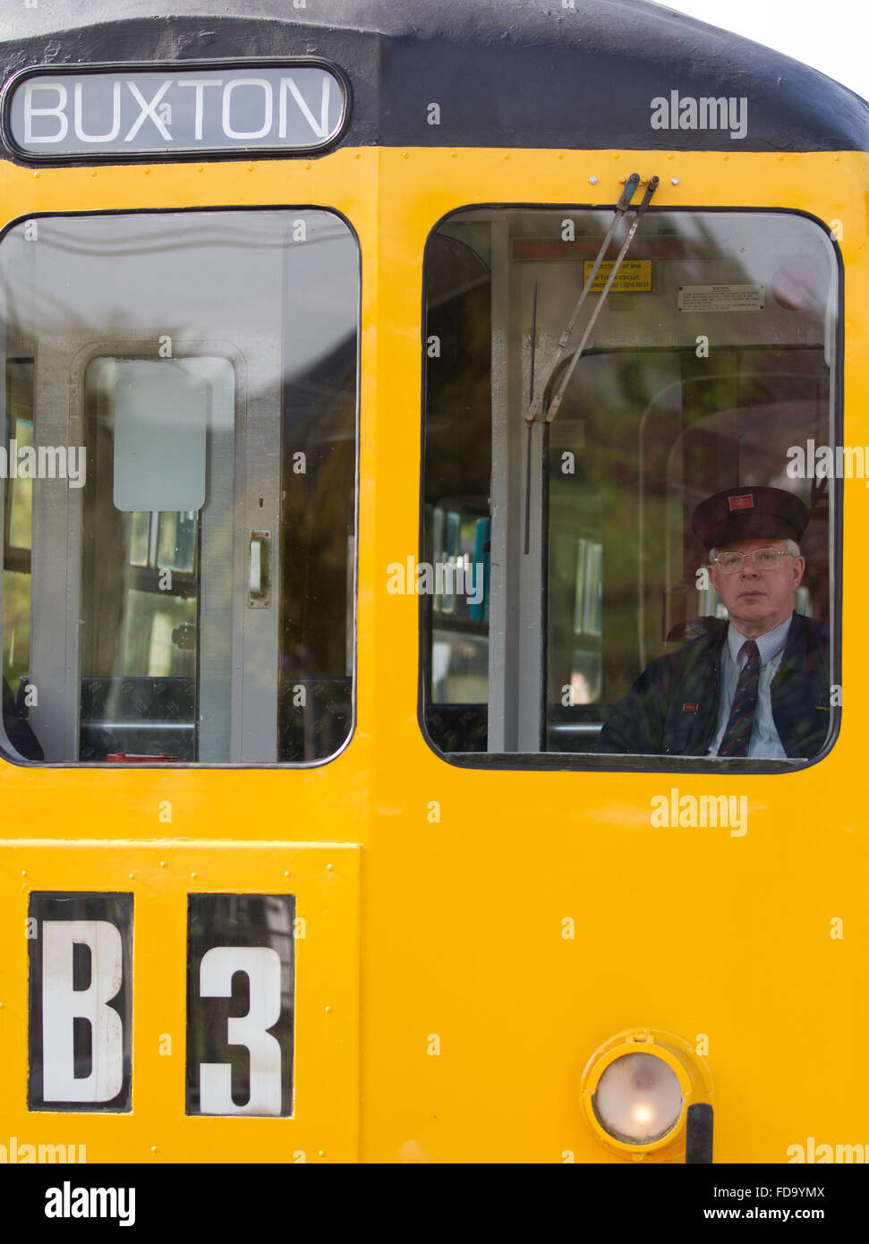A re-enactment of the 1960's as the British Rail diesel railcar driver waits for the signal to depart. - Stock Image