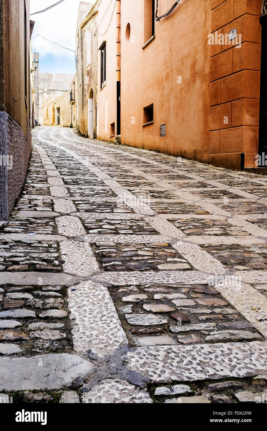 Cobbled street and building exteriors in Erice, historic town and comune in the province of Trapani, Sicily. - Stock Image